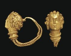 archaicwonder:  Hellenistic Greek Gold Maenad Earrings, c. 3rd-2nd Century BCEach maenad has a crown of ivy and berries in her curly hair, with incised strands along the cheeks, one with a band across the forehead and a diminutive Egyptianizing crown formed of a solar disk and cow horns, and one with a crosshatched trapezoidal pendant along the forehead. In Greek mythology, maenads were the female followers of Dionysus. Often they were portrayed as inspired by Dionysus into a state of…
