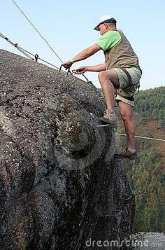 Man climbing rock by Claudia Fernandes, via Dreamstime