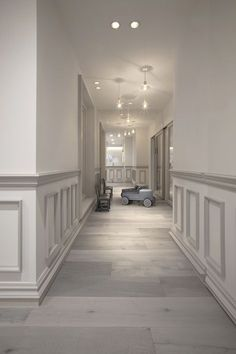 Muted grey & white-toned wainscoting adds old-world charm to a modern home.