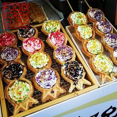 King Kong Waffle stand somewhere in Hongdae, Seoul. Each section is covered with a small scoop of vanilla ice cream, whipped cream, and powdered sugar before being drizzled with sauces (chocolate, strawberry, kiwi, blueberry)