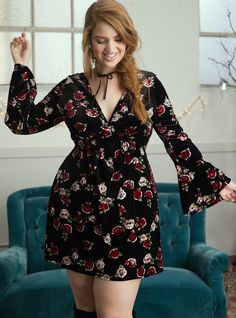 """We love that only the best 90's trends are coming backaka velvet, babydoll, and floral prints. This mini is best when paired with platforms, the sumptuous black velvet design gets funky with bell sleeves. The cinched bust has all eyes on your buds.<div><b><br></b></div><div><b>Model is 5'11"""", size 1<br></b><div><ul><li style=""""LIST-STYLE-POSITION: outside !important; ..."""