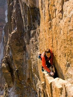Climber on rock face.
