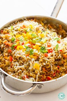 ONE POT SPICY TACO RICE SKILLET   ==INGREDIENTS== 1lb ground beef, 1 large onion,  2 bell peppers,  1 can tomatoes with green chills, 1 c salsa, 1 c long grain white rice (NOT minute rice), 1 c water, 1 c beef stock, 2 t cumin, ½ t cayenne pepper, 1 t chili powder, 1 t garlic powder, 1 t smoked paprika, 1 c shredded cheddar or jack cheese, green onions, to garnish====