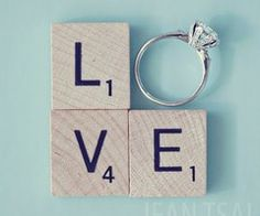 Scrabble tiles & engagement ring for photo of marriage announcement.