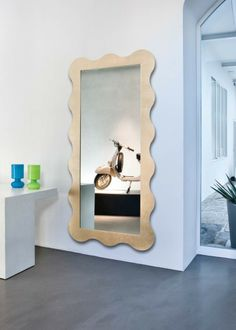 ROUND design giulio cappellini This radiator is a downright furnishing accessory: the function of the ample central mirror is exalted by the rhythm of its gold leaf finished frame. It's a new type of product characterized by great design.  #home #radiator #design #aluminum #interiordesign #forniture