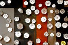Wall of vintage car lights. Jamie's Italian, London designed by Blacksheep.