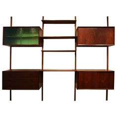 Danish Mid Century Modern Teak Wall System Shelving Bar Cabinet | From a unique collection of antique and modern shelves and wall cabinets at https://www.1stdibs.com/furniture/wall-decorations/shelves-wall-cabinets/