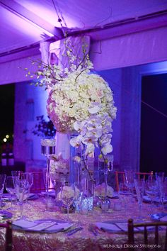 Tall centerpiece featuring roses and cascading orchids. Wedding and design by Tiffany Cook Events