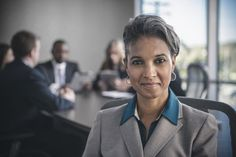 Businesswoman smiling in conference room
