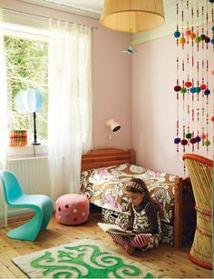 Another success with mixing and matching fabrics and patterns. The pompom curtain adds a bit of boho. Love the modern Panton Junior chair in here too.