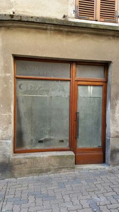 Mysterious abandoned storefront in Rodez, France