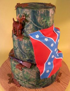 Camo wedding cake with a confederate flag! Love!