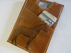 5. slim wallet. ($14.00 but you can customize it with the image of your choice, pick something good!!)