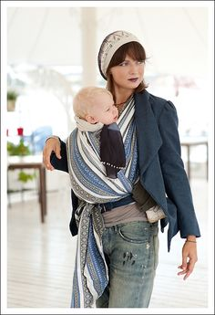 Front Cross Carry with a woven wrap video and photo tutorials from Wrap Your Baby.  This is my favorite easy front carry for a woven wrap.