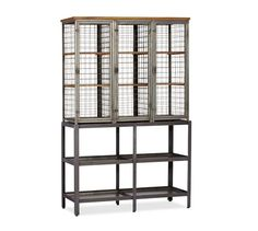 """Gridley Caged Storage Cabinet from Pottery Barn. Modeled on the caged lockers once used in factories and gymnasiums, this cabinet has a bold, industrial appeal. Crafted with a steel frame, mahogany shelves, and wire mesh panels. Three doors open to nine fixed shelves; doors lock with drop down latches. Includes four spacious bottom shelves. 49.25""""W x 17""""D x 77.25""""H. $1399.00. On sale now for $979.99"""