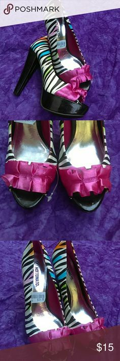 NWT Pink White And Black Zebra Heels With Rainbow New. Size 7. In excellent condition. Shoes Heels
