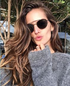 Airport chic: 'Fasten your seat belt ... Next stop?!!' Izabel captioned this selfie before heading to Mauritius