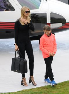 On the go: Despite the overnight flight, Ivanka looked chic and refreshed in an elegant bl...