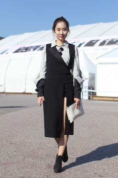 Notepads Out! 20 Next-Level Seoul Street-Style Snaps #refinery29  http://www.refinery29.com/2013/10/55989/seoul-korea-fashion#slide-12  The asymmetric cutout dress is amazing on its own, and then she adds a shirt that is giving birth to another shirt. Boom — Fashion Week, owned....