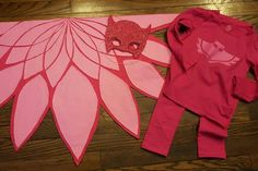 "Owlette costume. I finally did it. Made with two colors of felt for wings. Felt and glitter foam for the mask (i couldn't help but add glitter) and made a dark tshirt transfer and applied it to shirt and pants from Children's place. actually did it finally. Now that I made the wings, I would start them differently if I did it again. I found the mask at disney jr UK site and everything else I just ""winged"" in illustrator and by hand. My 3.5 yr old loves it! Wing how to in the comments"