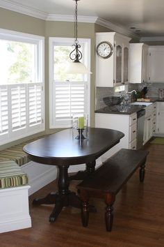 kitchen nook in bay window. I like the bench seat on the window side.
