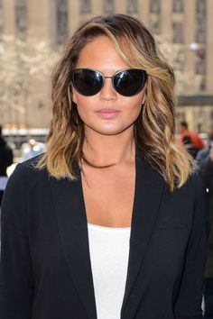 Chrissy Teigen's cat eye-sunglasses. See it and 9 other pretty celebrity spring beauty looks worth trying.