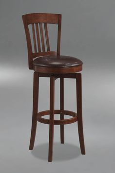 Hillsdale Canton Swivel Counter Stool. The Canton, available in a brown finish, is a 360 degree swivel barstool with dark brown faux leather seat,  a traditional mission back design and simple, tapered and slightly flared legs.  Composed of hardwoods and climate controlled wood composites, minor assembly required.