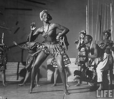 Issa Niang performing with touring Ballets Africans company. New York,  1959.