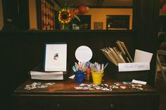 Ask your guests to get artsy on loose scrapbook pages for your guest book.bull dog clipped boards, loose paper, sticky backed mini photos and writing utensils. Reception Activities, Party Activities, Library Wedding, Wedding Guest Book, Wedding Prep, Casual Wedding, Atheist Wedding, Guest Book Tree, Guest Books