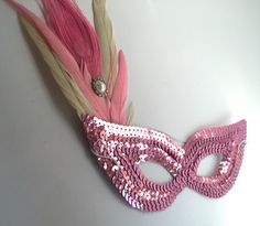 A personal favorite from my Etsy shop https://www.etsy.com/listing/250225197/sale-pink-peacock-feather-sequin-eye