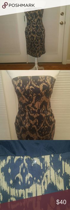 Michael Kors strapless cotton dress size 2 Beautiful Michael Kors navy blue and tan strapless dress.  Great for formal or more casual events. 98% cotton, inside is lined.  Excellent condition, no signs of wear. Size 2. MICHAEL Michael Kors Dresses Strapless