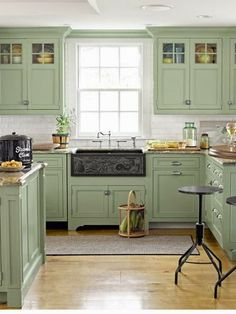 How about a little pop of color in the kitchen with some painted cabinets - #Country #Kitchens | http://homechanneltv.blogspot.com/2014/05/cottage-style-kitchens.html