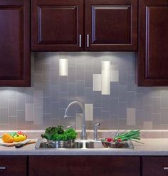Backsplash with 3x6 on vertical, second color introduced to compliment the counter top material