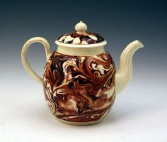 Early English pottery surface decorated creamware teapot in mocha colors