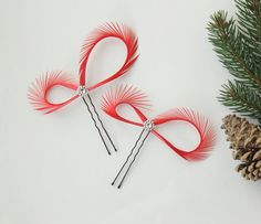 Red hair accessories, feather hair pins created with red goose biots, adorned with tiny flower beads, a whimsical piece for a bride to be or her
