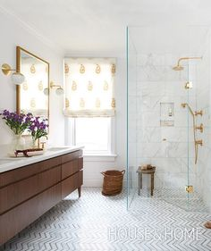 A paisley-printed roman blind, walnut vanity and brass accents give this white bathroom a warm, welcoming feel.   Photographer: Alex Lukey   Designer: Sam Sacks
