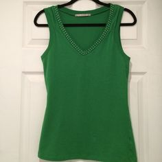 Very nice green tank top excellent shape! 95% Cotton and 5% Spandex! Size says large but maybe really a medium! Trimmed in rhinestones! PaPaYa Tops Tank Tops
