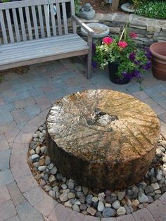 Millstone fountain contemporary patio