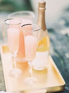Top off your peach colored wedding with this tasty peach bellini + *everyone* will surely be a peach lover.