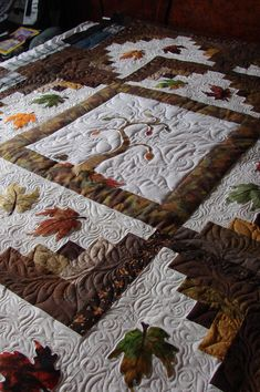 http://www.quiltingboard.com/pictures-f5/%22autumn-has-arrived%22-now-going-back-home-t92484.html