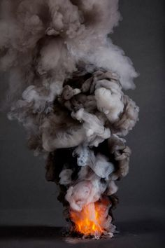 Admiring the beauty of smoke, this image is number 5 in a collection entitled: Controlled Burns Series taken by photographer: