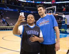Photo Gallery: Season Ticket Member Party - April 1, 2014 | THE OFFICIAL SITE OF THE OKLAHOMA CITY THUNDER - Nick Collison