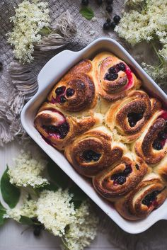 These elderflower and black currant rolls not only look delicious, they are filled with elderflowers, which balance the sweetness of the brioche rolls.