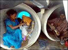 Indian slum-dwellers take refuge in unused sewage pipes in Mumbai