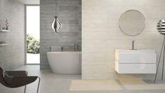 Cuarto de baño diseñado con los nuevos modelos de cerámica para interiores. Paredes en tonos grises y blancos con azulejos decorativos crean un ambientes perfecto del mas puro estilo minimalista