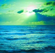 Green and blues hues sunset - what a stunning print this would be for a room.