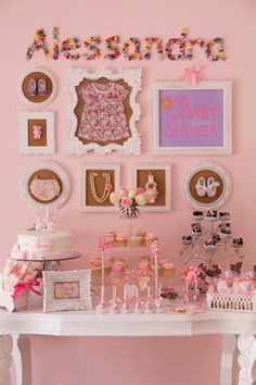Vintage chic baby shower - love the idea of framing heirloom baby items in a fun gallery wall! #babyshower