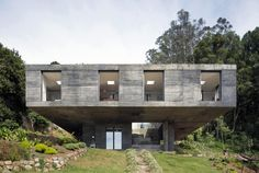 This Fascinating Square Concrete House Sits on a Small Pedestal