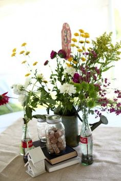 I love these center pieces with Coke bottles as vases.