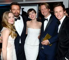 Les Miserables' Anne Hathaway (in Chanel, flanked by Amanda Seyfried, Hugh Jackman, director Tom Hooper and Eddie Redmayne at NBC's viewing party)